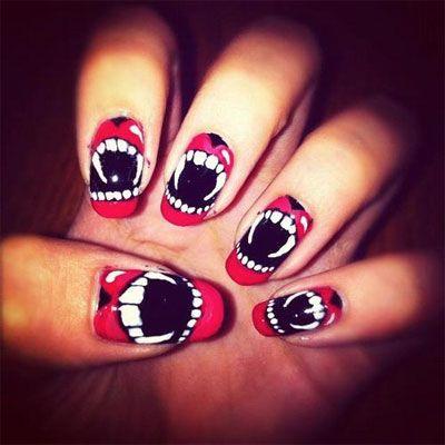 Halloween fangs manicure.