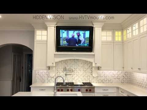 This Hidden Tv Mount Will Make You Want To Put A Tv In Every Room Tv In Kitchen Kitchen Cabinet Layout Kitchen Pantry Design