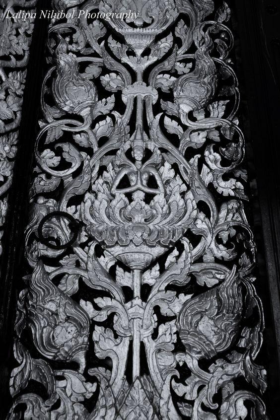 Sculptural relief covering a door panel of Wat Potaraam, Surat Thani Province.
