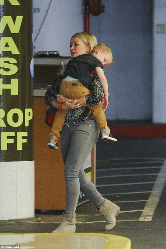 Big day out: Hilary Duff had a very tired three-year-old, son Luca, on her hands after a f...