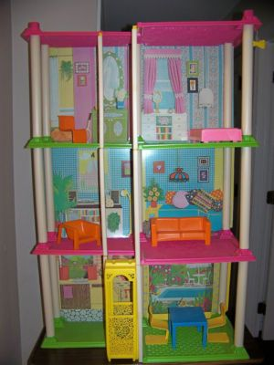 Vintage Barbie Townhouse '70's I got this for Christmas when I was little.  My granny made furniture for me out of tissue boxes and spools.  HOURS of fun.