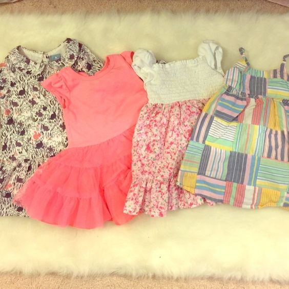 Baby dresses 4 lovely dresses. Used once. Like new. No stains. Baby Gap, Old Navy, Ralph Lauren. Size 6-12 mos, 12 mos, 12-18 mos.  very well priced! Baby Gap, Ralph Lauren, Old Navy Dresses