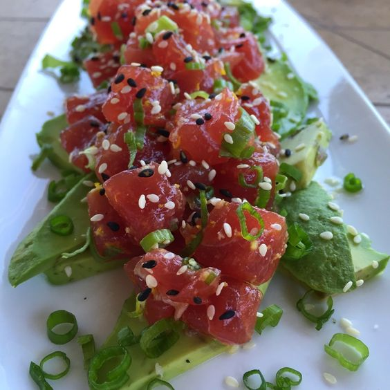 Fresh citrus, ginger, and sesame oil are a great marinade for ahi tuna tartare. Serve with avocado and green onions as an appetizer, or a main meal!
