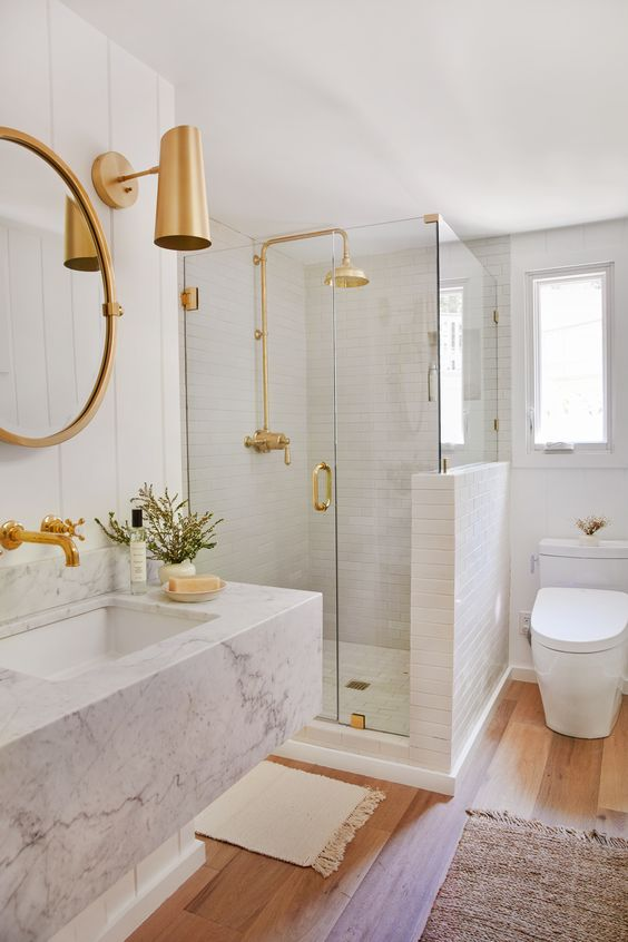 We completely updated the bathroom in the #JKLakeHouse and started with a neutral canvas of white walls and oak flooring. We completed the look with modern finishes like the marble sink and upscale, clean-lined Aimes WASHLET+ toilets from TOTOUSA