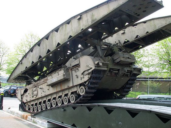 An armoured vehicle-launched bridge (AVLB) is a combat support vehicle, sometimes regarded as a subtype of combat engineering vehicle, designed to assist militaries in rapidly deploying tanks and other armoured fighting vehicles across rivers. The AVLB is usually a tracked vehicle converted from a tank chassis to carry a folding metal bridge instead of a turret. The AVLB's job is to allow armoured or infantry units to cross water, when a river too deep for vehicles to wade through is…