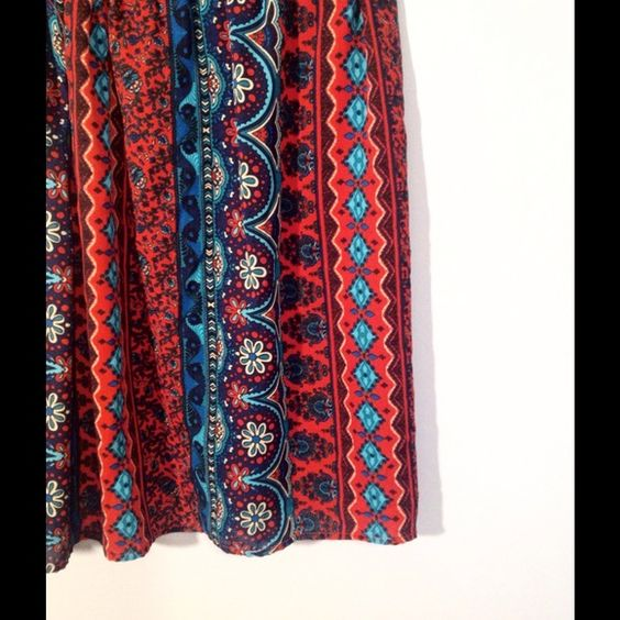 Miami Tribal Pattern Skirt Beautiful tribal pattern in bright vibrant colors. Elastic waist band is slightly twisted bc of a few stitches pulled from seam, can be fixed easily by someone that sews (I don't ) otherwise skirt is in like new condition! Miami Skirts
