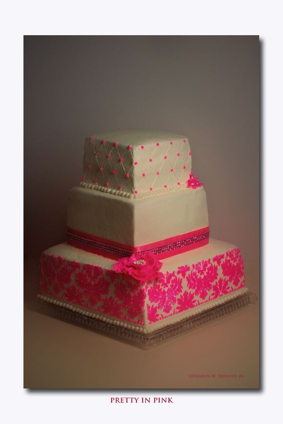 """- Wedding cake done in buttercream with damask stenciling. 12"""", 8"""" and 6"""" cakes. First time for stenciling."""