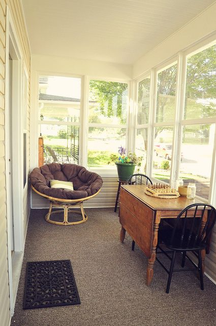 Enclosed front porch with dropleaf table to think a front for Small enclosed deck ideas