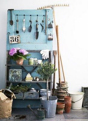 Garden Shelf from an old door.  I need more old doors, shutters, etc. hanging around so I can do all of these cool ideas!
