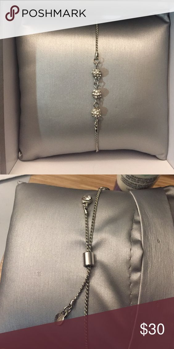 Silver Pull Tie Bracelet with 3 Balls Brand new in box. Adjustable silver closure. Box and pillow included. Unknown brand (it was a gift) Jewelry Bracelets