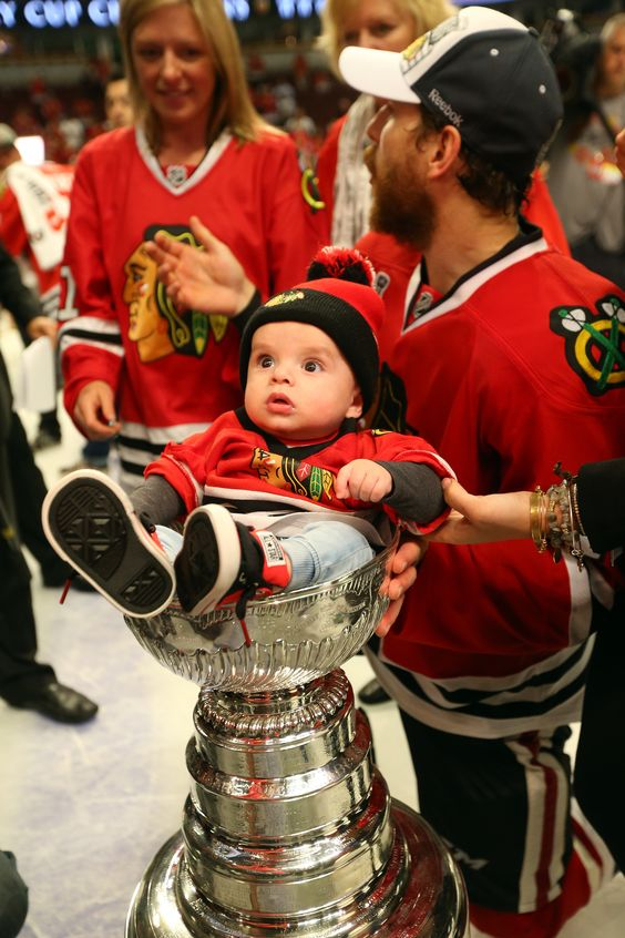 Andrew Desjardins places his son in the Stanley Cup! #Blackhawks #Baby