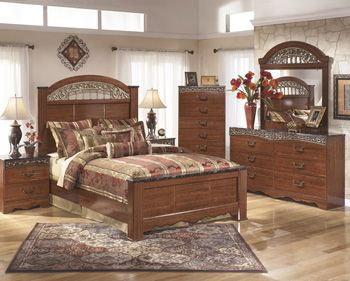 """The """"Fairbrooks Estate"""" bedroom collection features warm finishes and ornate detailing to create a furniture collection that is sure to enhance your bedroom decor with an inviting traditional design. The glossy reddish-brown finish that flows smoothly over the replicated cherry grain is beautifully enhanced by the deeply carved scroll motifs finished in an antique gold color and the ornately decorated inserts."""