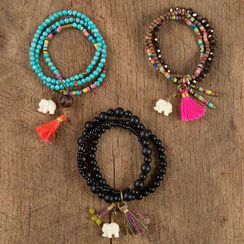 This bracelet is sure to become a favorite! It features turquoise stone, back matte stone and wooden beads accented with a cute lucky elephant charm, beaded charms and a fun tassel.