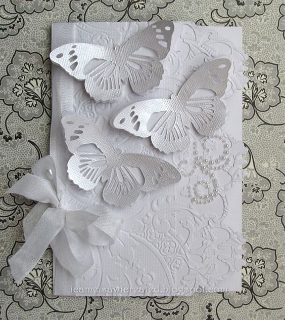 Made with new Anna Griffin embossing folders, and Anna's Cricut butterfly.: