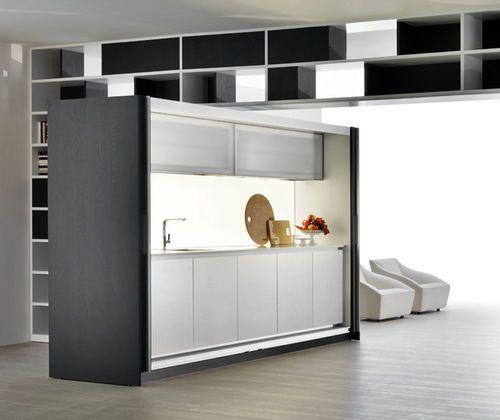 Cuisine dissimulée / avec portes escamotables TIVALI by Dante Bonuccelli Dada