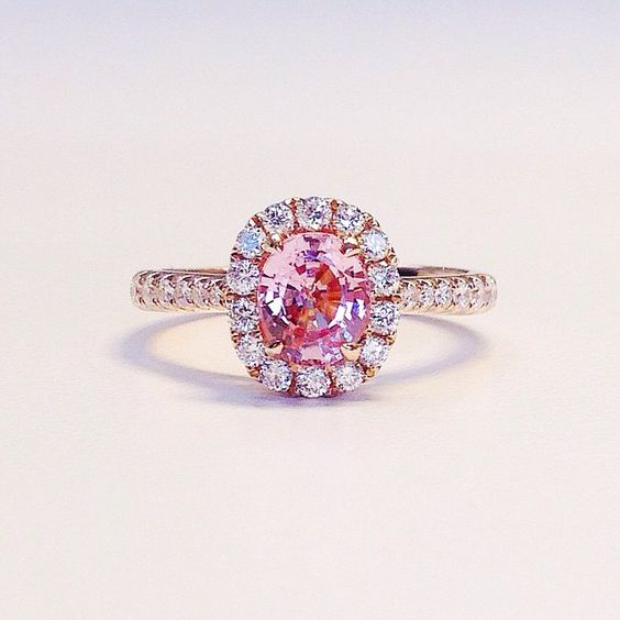 Engagement ring inspo:  this peachy pink sapphire center stone in rose gold…: