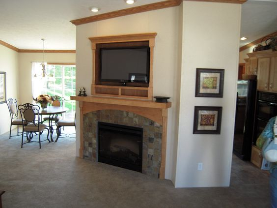 Corner Fireplace With Flat Screen Lcd Tv Above The Dining Room Is Located To The Left In This