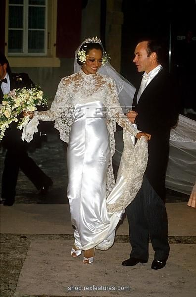 Diana Ross at her marriage to Arne Naess in 1985 he she wears a very flavours looking wedding gown with he lace sleeved keeping it fe mined and the silky dress giving a glamours feel. The tiara gives a diva like look which is classic to her style. Her wedding dress would have influenced many brides at the time with her being a big influenced on fashion and style,