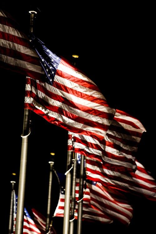 Flags Of The United States Of America On Flag Poles Under Dark Sky Veteran Veterandadayoffiamworkin American Flag Images American Flag Pictures Old Glory Flag