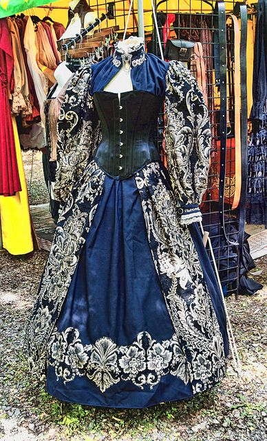 This right here is why I can never go to a renaissance faire! Instant rage at whoever paired a Victorian corset with what appears to be intended as an Elizabethan gown. Arg!