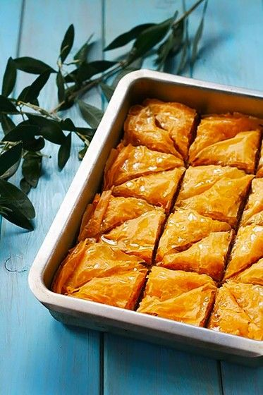 Easy Baklava Recipe with Honey and Pistachios - This Classic Greek Baklava Recipe features layers of flaky dough filled with ground nuts and honey! Is a prefect recipe for family functions, parties, or for gifting!