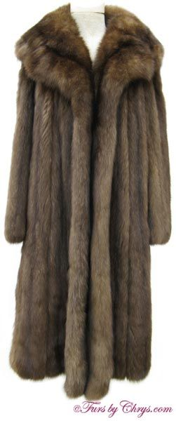 Christian Dior Russian Sable Fur Coat #RS665; $30,000.00; Excellent Condition; Size range: 8 - 14. This is a magnificent genuine natural Christian Dior Russian sable fur coat. It features a very large and extra-lush notched collar. As with many sable coats, it has an open design (no closures). It has a multitude of silvery tips as you would expect from a fur of this caliber (a sign of a very high quality sable). It appraised for One Hundred Fifty-Five Thousand Dollars (a copy will be…