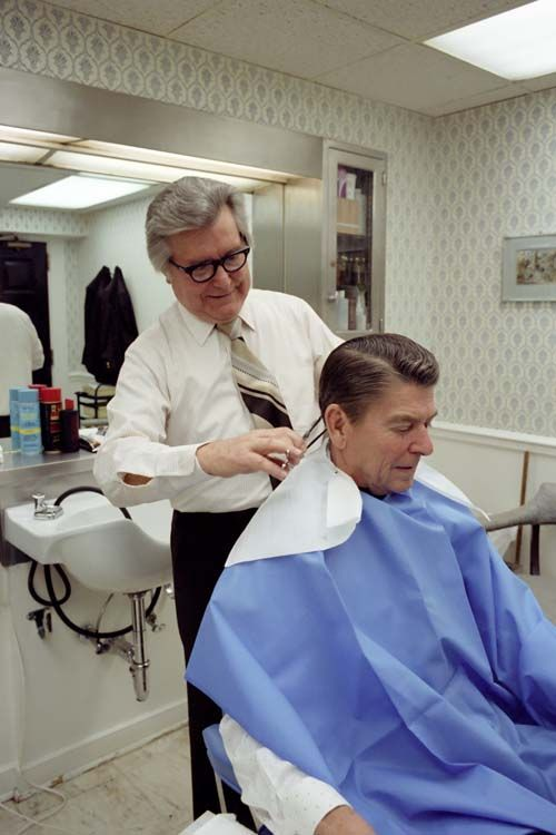 Ronald Reagan getting a haircut in the West Wing Barber Shop by Milton Pitts on January 23rd, 1981. Milton Pitts was the barber for Richard Nixon, Gerald Ford, Reagan, and Bush 1!