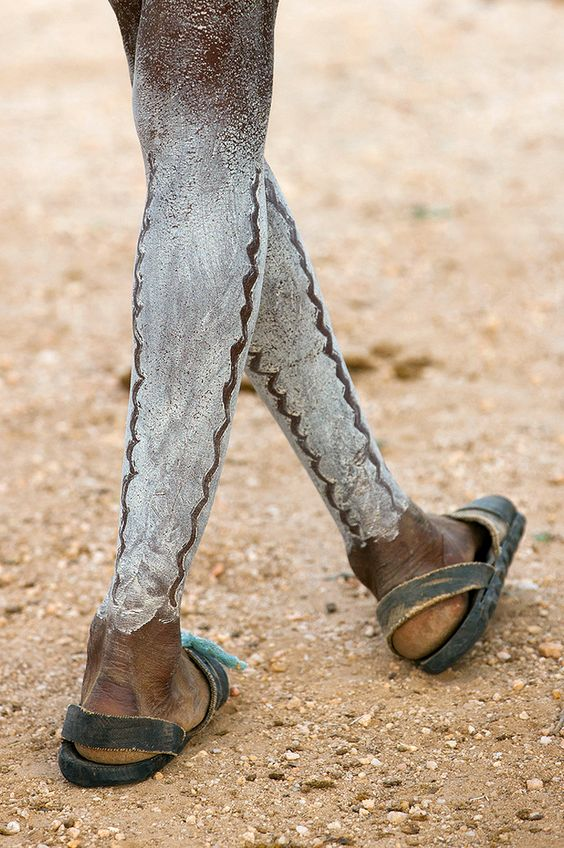 Africa | Painted legs of a Hamar man at the Bull Jumping Ceremony. Turmi, Omo Valley, Ethiopia | ©Eric Lafforgue