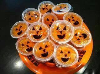 Draw jack o lantern faces on mandrin orange containers