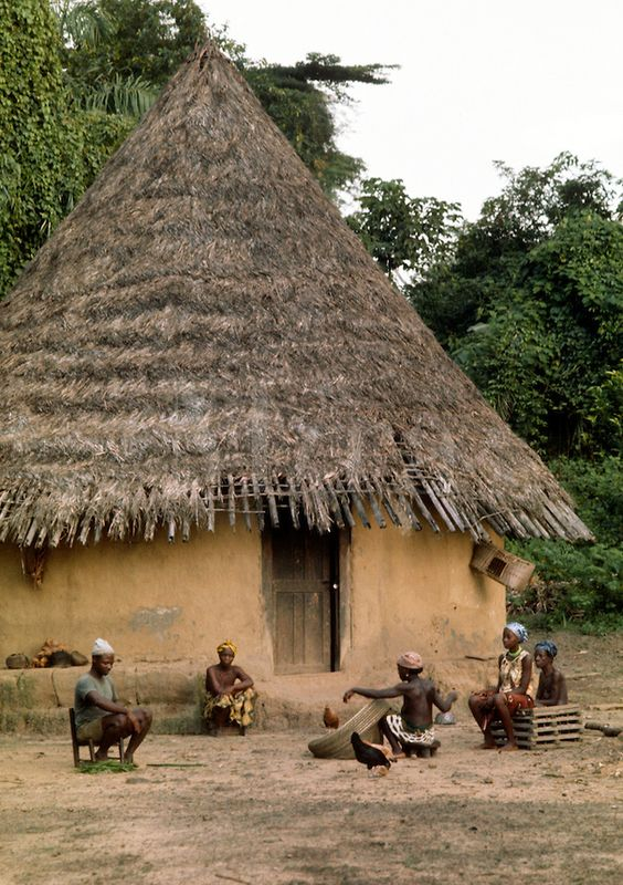 Liberia - Kpelle tribe, village scene,  traditional cylindrical house.