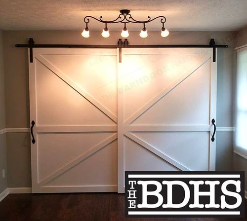 Double Door Single Track By Pass C Sliding Barn Door Hardware System Shown With Two British Brace Door Garage Door Design Double Barn Doors Barn Doors Sliding