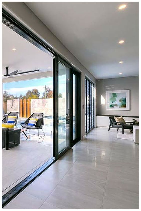 When Wideline Stacking Doors Are Opened They Provide Seamless Transition From Outside To In And Flood Your R Stacking Doors Stacker Doors Kitchen Sliding Doors