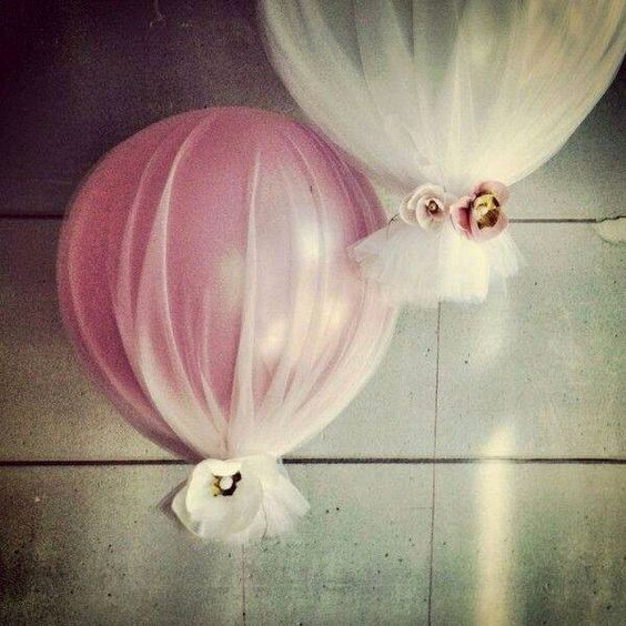 What a pretty and cheap baby shower idea...wrap balloons with tulle and tie it at the bottom for a decoration. Lovely.
