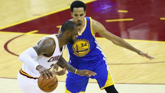 #NBA CLEVELAND, OH - JUNE 16:  LeBron James #23 of the Cleveland Cavaliers handles the ball against Shaun Livingston #34 of the Golden State Warriors in Game 6 of the 2016 NBA Finals at Quicken Loans Arena on June 16, 2016 in Cleveland, Ohio. NOTE TO USER: User expressly acknowledges and agrees that, by downloading and or using this photograph, User is consenting to the terms and conditions of the Getty Images License Agreement.  (Photo by Ezra Shaw/Getty Images)