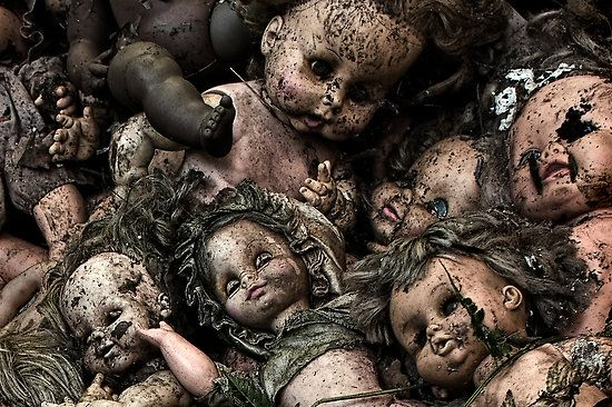 Decayed and eroded dolls at an abandoned furniture factory in Buffalo New York.: