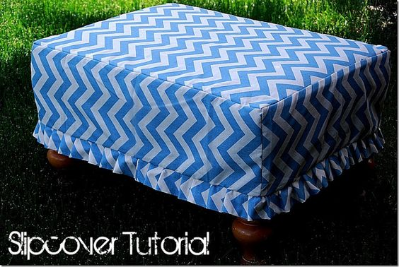 Cover a storage ottoman with a slipcover.  Easier than reupholstering.  Easy tutorial although I'm not crazy about her fabric choice...