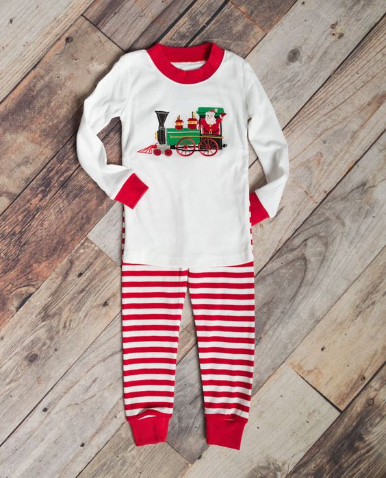 The holiday festivities will chug along in comfortable style with these sure to be a favorite train holiday pajamas for infant, toddler and little boys.  This two piece Santa and train applique Christmas pajama set for boys includes a solid white shirt with red cuff and neckline accent and a pair of candy cane stripe bottoms.  These boys Christmas pjs are sure to be the favorite of the season for your little train-lover!