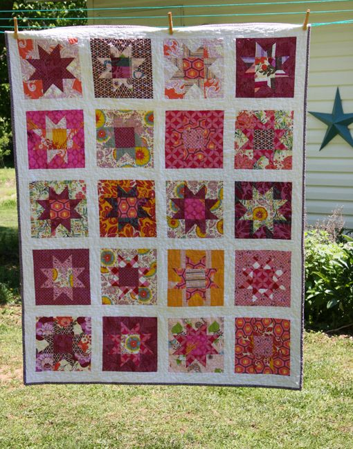 """Patchwork Stars.  100% cotton. This quilt is a scrappy mix of designer quilt fabrics including Amy Butler, Heather Ross, Anna Maria Horner, Denyse Schmidt and others.  Measures 45""""x56""""."""