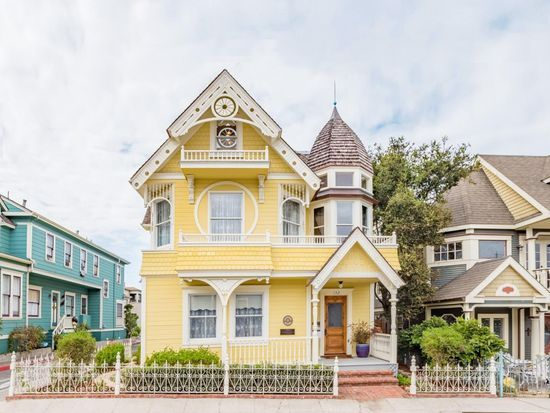 A Charming Yellow Victorian House Called The Daffodil In Pacific Grove Ca For Sale In Pacific Grove Yellow House Exterior Victorian Homes White Exterior Houses