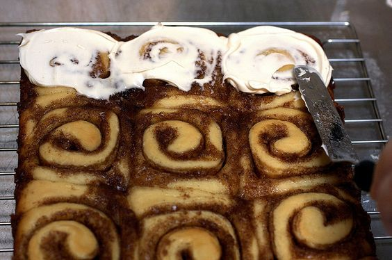 icing with cream cheese frosting by smitten, via Flickr//Something about Christmas makes me have cinnamon rolls on the brain