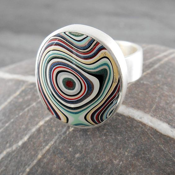 One of the first cabs I ever sold :)         Fordite and sterling silver ring  Psychedelic by CamaliDesign on Etsy