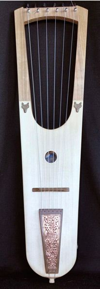 This is very similar to what Florian's lyre looks like in shape, though Florian's has seven strings and the colors and designs are different.