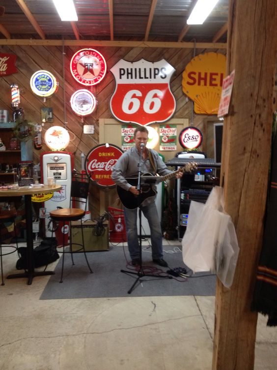 Country recording artist Ray Shavers performed at the store.  Backdrop is the gas/oil memorabilia area.