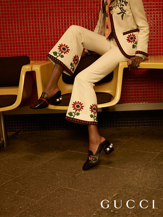 Gucci white cady crêpe pant suit with embroidered flowers and trimmed with blue and red crochet detail.