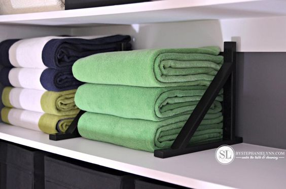 Linen Closet Shelf Dividers, use shelf supports held in place with Locktite to help organize your closets.