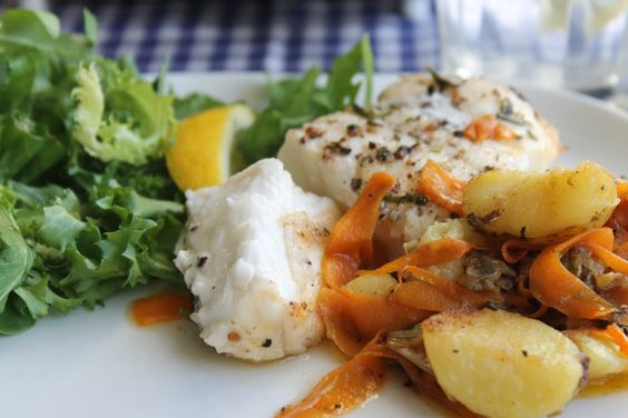 ocean catfish with carrot strips and potatoes