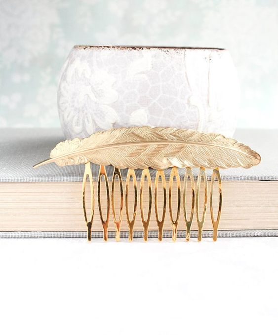 This is a beautiful large feather hair comb in raw gold brass. The focal piece of this lovely hair comb is the large detailed gold feather. The