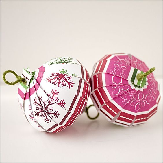 Paper Christmas Balls made from heavy cardstock type of scrapbook paper. Recycled options could be: paint chips, greeting cards or an old gift bag - image found at http://thecraftysisters.com/2011/12/10/christmas-ornament-countdown-scrapbook-paper-balls/
