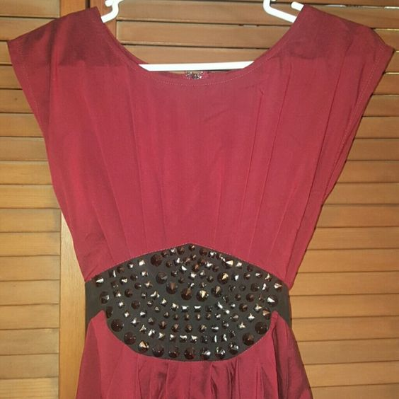Beautiful burgundy studded dress Built in belt ties in back. Elegant dress. Brand new with tags. Ya Los Angeles Dresses Midi