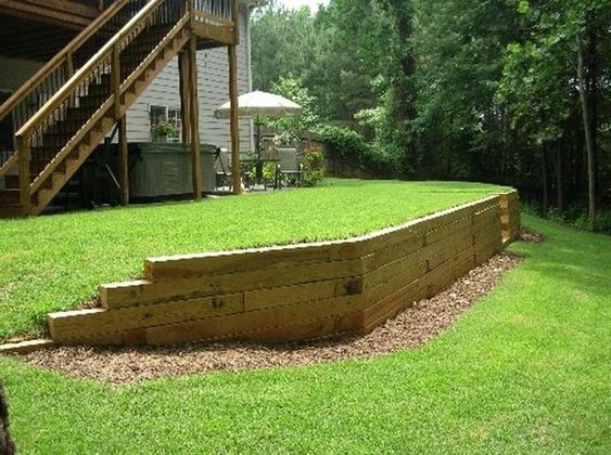 37 Gorgeous Front Yard Retaining Wall Ideas Perfect For Your Front House Trendehouse Backyard Retaining Walls Sloped Backyard Backyard